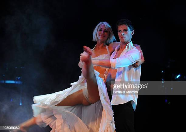 Brian Fortuna and Ali Bastian perform during a photocall for their upcoming dance show 'Burn The Floor' at Shaftesbury Theatre on July 23 2010 in...