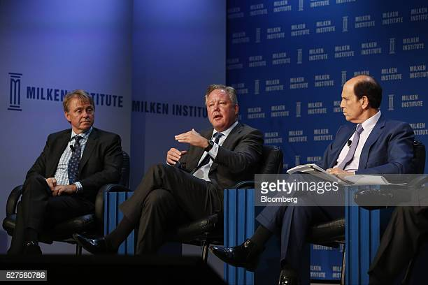 Brian France chairman and chief executive officer of NASCAR center speaks as Wesley Edens founder and cochairman of Fortress Investment Group LLC and...