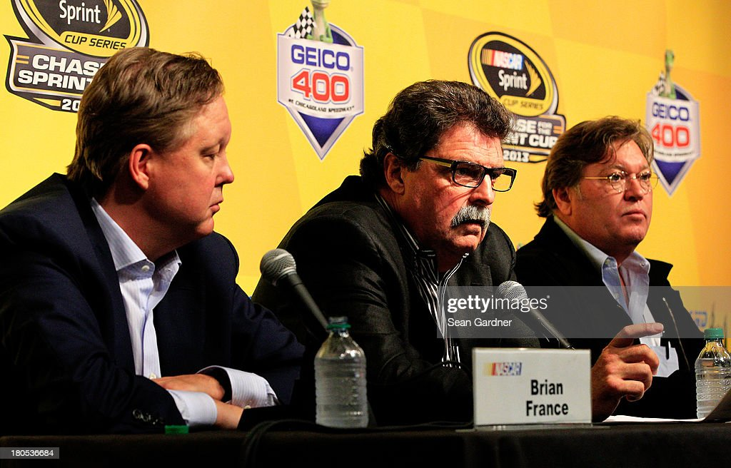 Brian France, chairman & CEO of NASCAR, Mike Helton, president of NASCAR, and Robin Pemberton, NASCAR Vice President, hold a press conference following a meeting with drivers for the NASCAR Sprint Cup Series at Chicagoland Speedway on September 14, 2013 in Joliet, Illinois.
