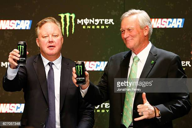 Brian France NASCAR Chairman and CEO and Mark Hall Chief Marketing Officer of Monster Beverage Co toast during a press conference as NASCAR and...