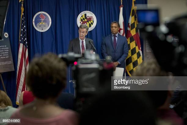 Brian Frosh Maryland attorney general left speaks as Karl Racine District of Columbia attorney general listens during a news conference in Washington...