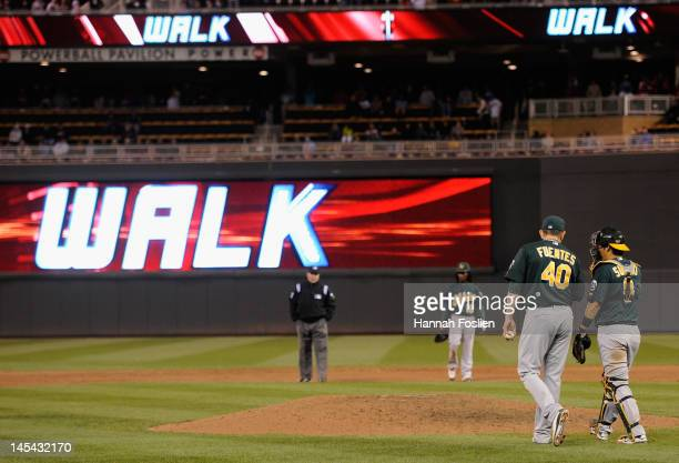 Brian Fuentes and Kurt Suzuki of the Oakland Athletics speak after walking Denard Span of the Minnesota Twins during the ninth inning on May 29 2012...