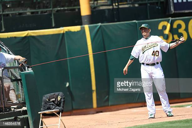 Brian Fuentes of the Oakland Athletics stretches in the bullpen during the game against the Texas Rangers at the OaklandAlameda County Coliseum on...