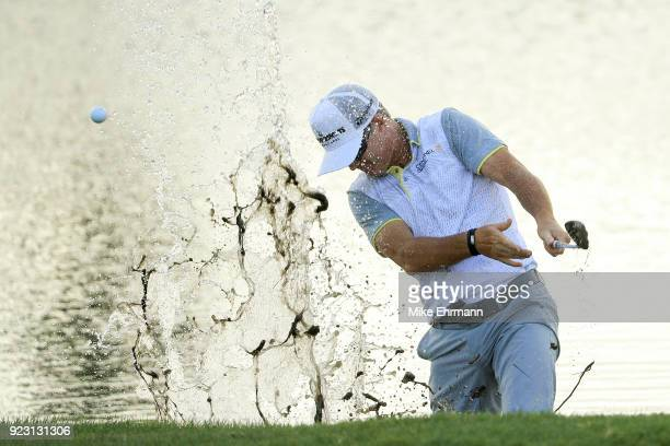 Brian Gay chips out of the water on the sixth hole during the first round of the Honda Classic at PGA National Resort and Spa on February 22 2018 in...