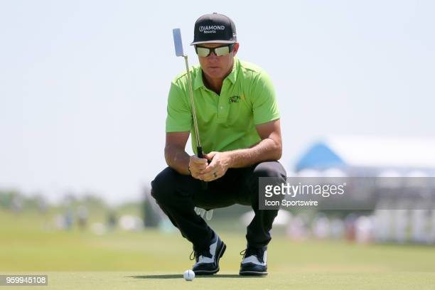 Brian Gay lines up his putt on during the second round of the 50th anniversary AT&T Byron Nelson on May 18, 2018 at Trinity Forest Golf Club in...
