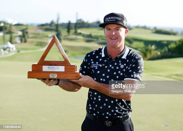 Brian Gay of the United States celebrates with the trophy after winning during a playoff during the final round of the Bermuda Championship at Port...