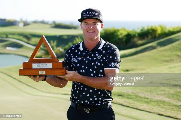 Brian Gay of the United States celebrates with the trophy after winning during a playoff in the final round of the Bermuda Championship at Port Royal...