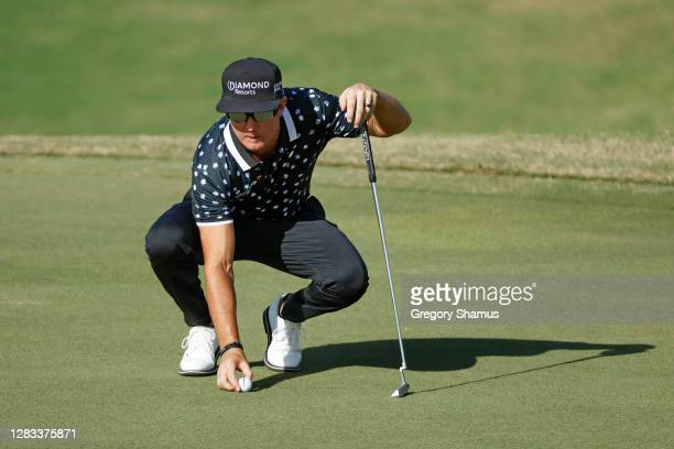 Brian Gay of the United States lines up a putt on the 17th green during the final round of the Bermuda Championship at Port Royal Golf Course on...
