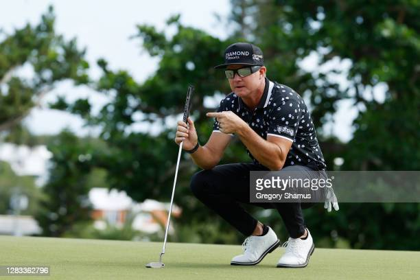 Brian Gay of the United States lines up a putt on the sixth green during the final round of the Bermuda Championship at Port Royal Golf Course on...