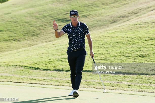 Brian Gay of the United States reacts after putting in for birdie to win a playoff on the 18th green against Wyndham Clark of the United States...