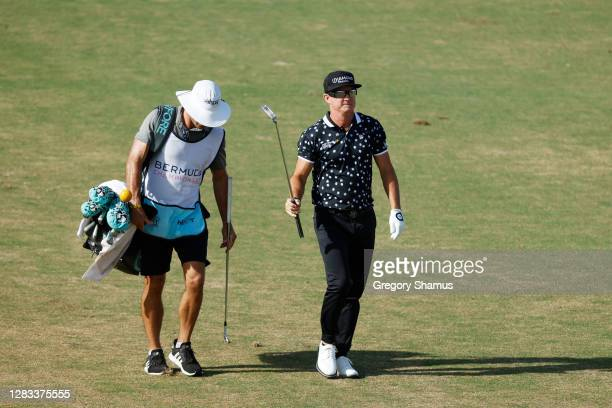 Brian Gay of the United States walks with his caddie on the 17th hole during the final round of the Bermuda Championship at Port Royal Golf Course on...