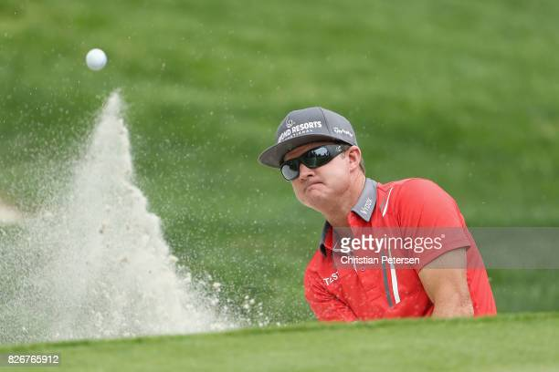Brian Gay plays his shot out of the bunker on the fifth hole during the third round of the Barracuda Championship at Montreux Country Club on August...