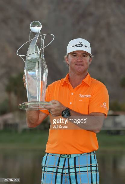 Brian Gay poses with the trophy after winning the Humana Challenge In Partnership With The Clinton Foundation at the Palmer Private Course at PGA...