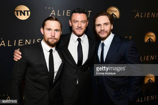 Brian Geraghty Luke Evans and Daniel Bruhl attend The Alienist LA Premiere Event at Paramount Studios on January 11 2018 in Hollywood California...