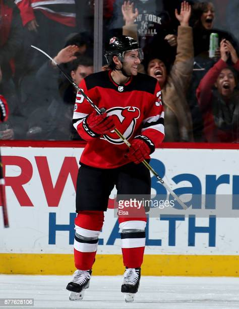 Brian Gibbons of the New Jersey Devils celebrates his goal to tie the game in the third period against the Boston Bruins on November 22 2017 at...