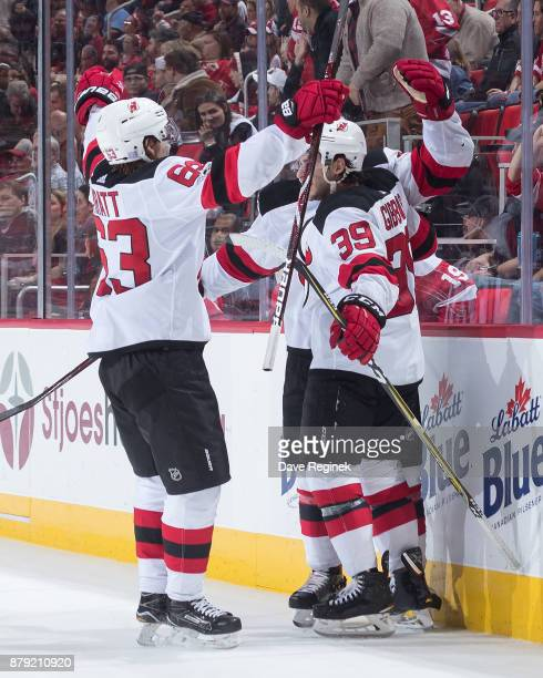 Brian Gibbons of the New Jersey Devils celebrates his overtime goal with  teammates Jesper Bratt and 158ca9642