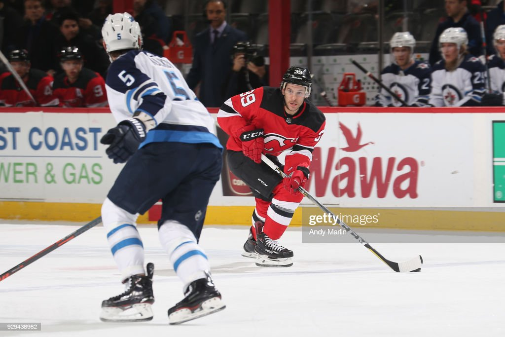 innovative design b0358 ec212 Brian Gibbons of the New Jersey Devils controls the puck ...
