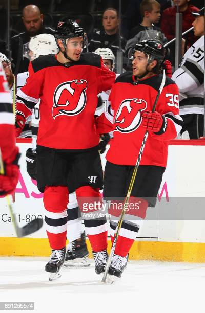 Brian Gibbons of the New Jersey Devils is congratulated by John Moore after  scoring a shirthanded 642f9d6eb