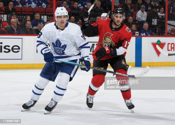 Brian Gibbons of the Ottawa Senators skates against Andreas Johnsson of the Toronto Maple Leafs at Canadian Tire Centre on March 30 2019 in Ottawa...