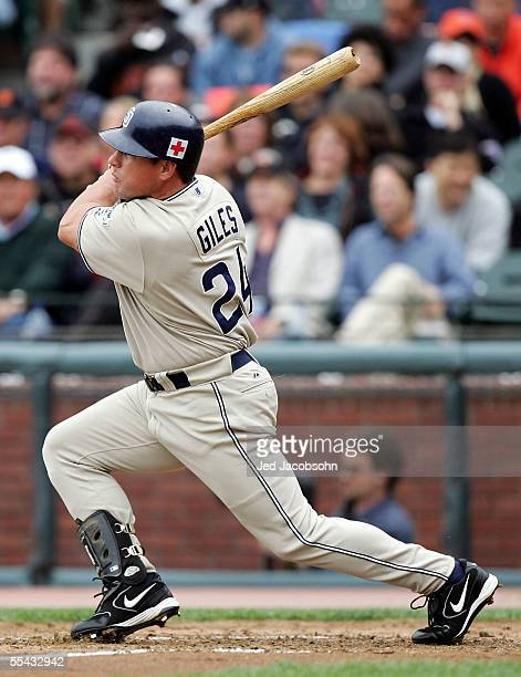 Brian Giles of the San Diego Padres hits an RBI single in the third inning against of the San Francisco Giants at SBC Park on September 14, 2005 in...