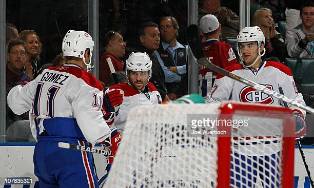 Brian Gionta is congratulated by Scott Gomez and Max Pacioretty of the Montreal Canadiens after scoring a goal against the Florida Panthers on...