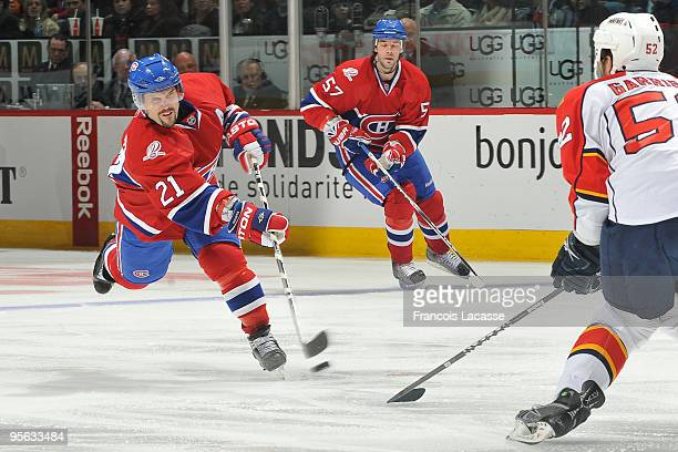Brian Gionta of Montreal Canadiens takes a shot in front of Jason Garrison of the Florida Panthers during the NHL game on January 7 2010 at the Bell...