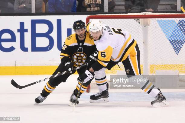 Brian Gionta of the Boston Bruins against Jamie Oleksiak of the Pittsburgh Penguins at the TD Garden on March 1 2018 in Boston Massachusetts