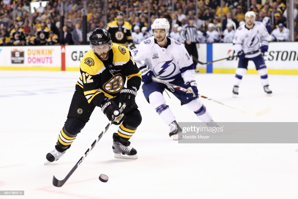 Brian Gionta #12 of the Boston Bruins skates against Chris Kunitz #14 of the Tampa Bay Lightning during the third period of Game Four of the Eastern Conference Second Round during the 2018 NHL Stanley Cup Playoffs at TD Garden on May 4, 2018 in Boston, Massachusetts.