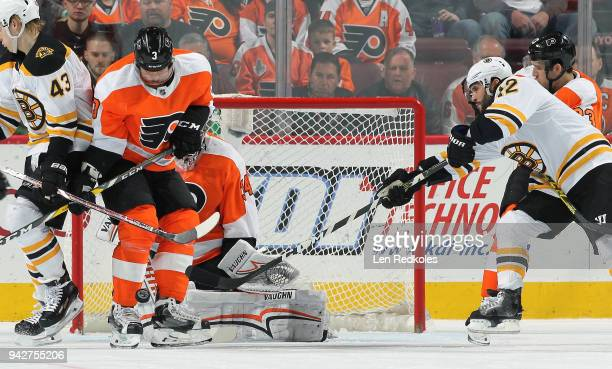 Brian Gionta of the Boston Bruins takes a shot on goal against Radko Gudas Brandon Manning and Petr Mrazek of the Philadelphia Flyers on April 1 2018...