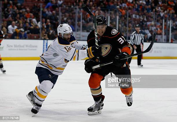 Brian Gionta of the Buffalo Sabres and Nick Ritchie of the Anaheim Ducks battle for position during the first period of a game at Honda Center on...