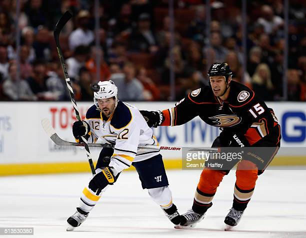 Brian Gionta of the Buffalo Sabres battles Ryan Getzlaf of the Anaheim Ducks for a loose puck during the second period of a game at Honda Center on...