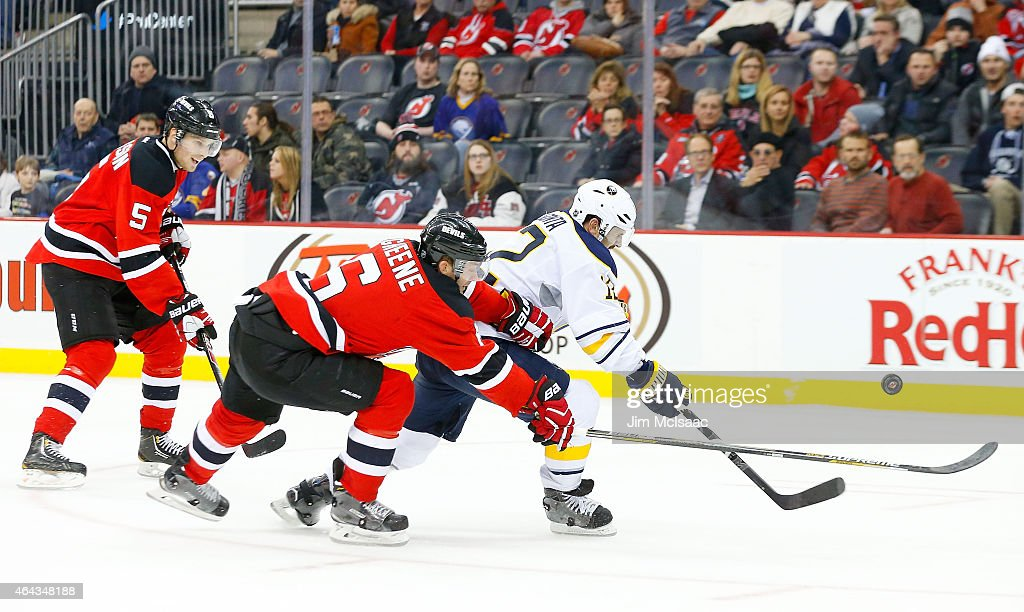 Brian Gionta #12 of the Buffalo Sabres in action against Andy Greene #6 of the New Jersey Devils at the Prudential Center on February 17, 2015 in Newark, New Jersey. The Devils defeated the Sabres 2-1 after a shootout.
