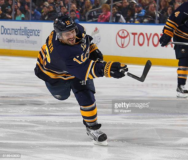 Brian Gionta of the Buffalo Sabres shoots the puck against the Winnipeg Jets during an NHL game on March 26 2016 at the First Niagara Center in...