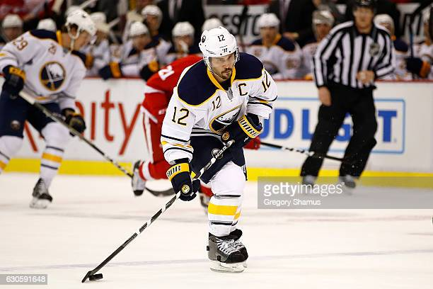 Brian Gionta of the Buffalo Sabres takes a firstperiod shot while playing the Detroit Red Wings at Joe Louis Arena on December 27 2016 in Detroit...