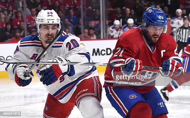 Brian Gionta of the Montreal Canadiens and Chris Kreider of the New York Rangers battle for the puck in Game Five of the Eastern Conference Final...