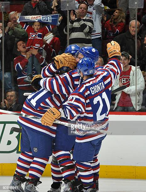 Brian Gionta of the Montreal Canadiens and teammates celebrate a goal during the NHL game against the Toronto Maple Leafs on October 31 2009 at the...