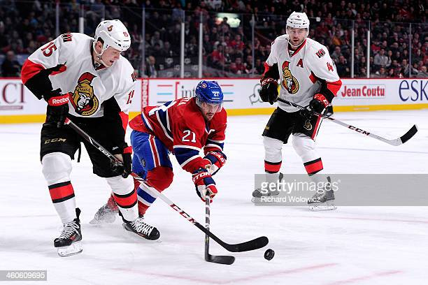 Brian Gionta of the Montreal Canadiens and Zack Smith of the Ottawa Senators battle for the puck during the NHL game at the Bell Centre on January 4...