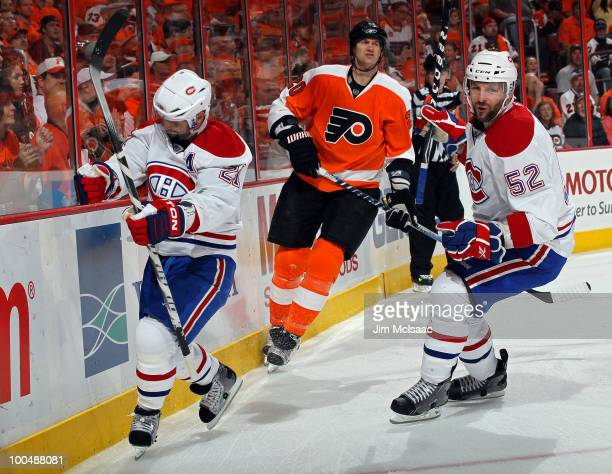Brian Gionta of the Montreal Canadiens celebrates with teammates Mathieu Darche after scoring a goal in the first period as Chris Pronger of the...