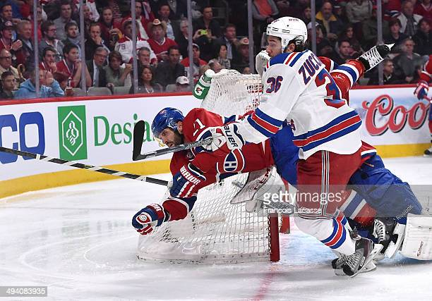 Brian Gionta of the Montreal Canadiens collides with Mats Zuccarello of the New York Rangers in Game Five of the Eastern Conference Final during the...