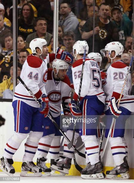 Brian Gionta of the Montreal Canadiens is congratulated by teammates Roman HamrlikScott GomezMathieu Darche and James Wisniewski after Gionta scored...
