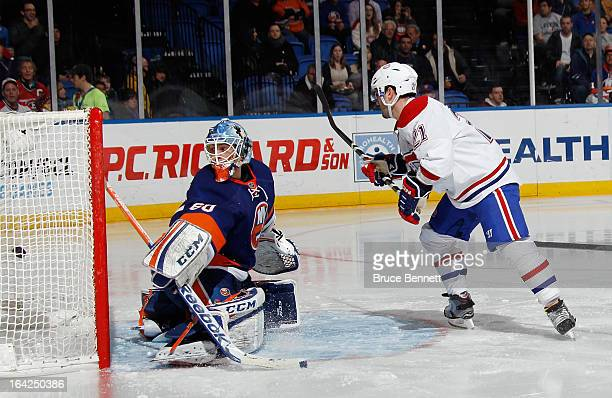 Brian Gionta of the Montreal Canadiens scores the game wining goal at 53 seconds of the third period against Kevin Poulin of the New York Islanders...