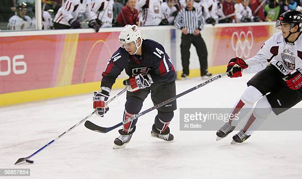 Brian Gionta of the United States controls the puck against Latvia during the men's ice hockey Preliminary Round Group B match on Day 5 of the Turin...