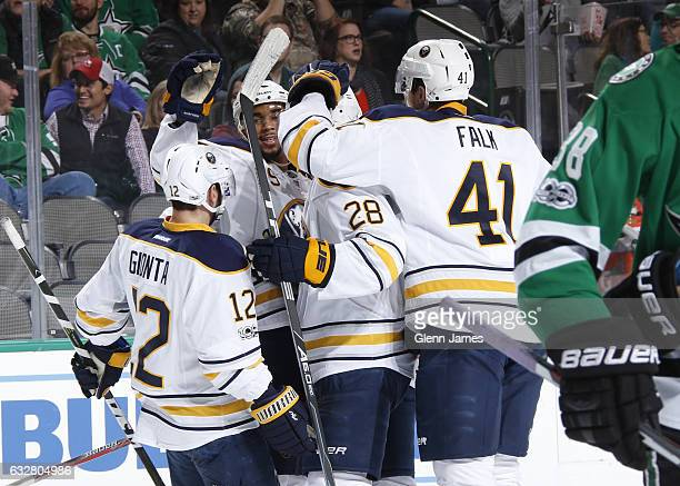 Brian Gionta Zemgus Girgensons and Justin Falk of the Buffalo Sabres celebrate a goal against the Dallas Stars at the American Airlines Center on...