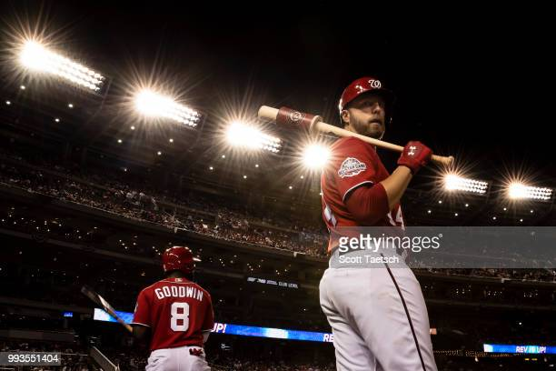 Brian Goodwin and Mark Reynolds of the Washington Nationals stand in the batters circle during the seventh inning against the Miami Marlins at...