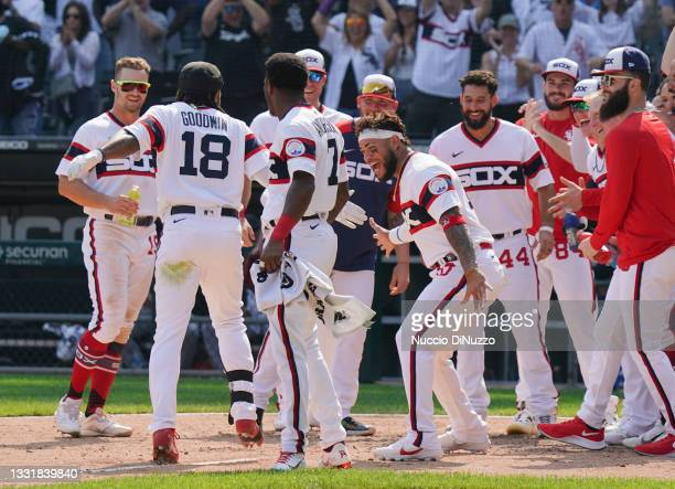 Brian Goodwin of the Chicago White Sox is congratulated by teammates following his walk off home run during the ninth inning of a game against the...