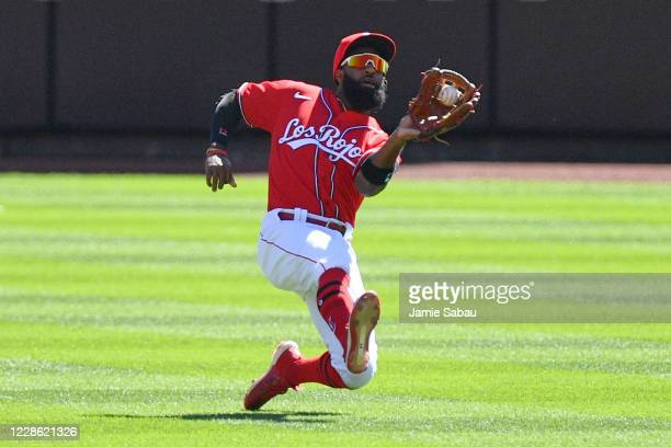Brian Goodwin of the Cincinnati Reds makes a sliding catch of a short fly ball in the centerfield in the first inning against the Chicago White Sox...