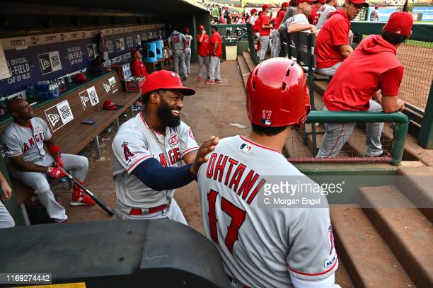 Brian Goodwin of the Los Angeles Angels and Shohei Ohtani of the Los Angeles Angels in the dugout before game two of a doubleheader against the Texas...