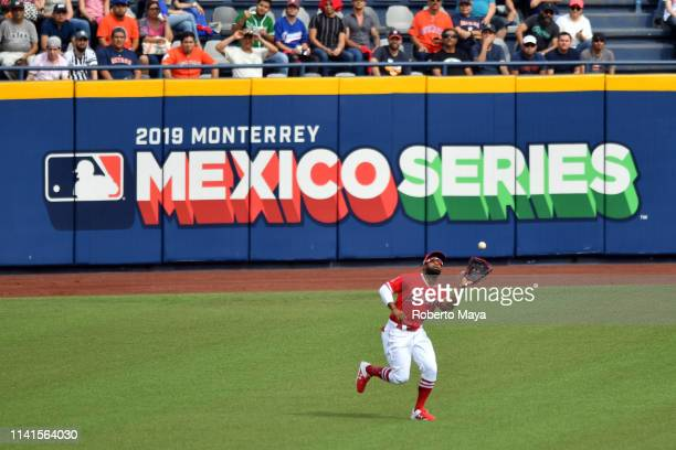 Brian Goodwin of the Los Angeles Angels catches a fly ball during the game between the Houston Astros and the Los Angeles Angels at Estadio de...