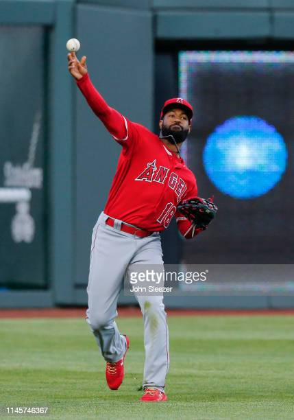 Brian Goodwin of the Los Angeles Angels of Anaheim fields and throws in a single by Adalberto Mondesi of the Kansas City Royals in the third inning...