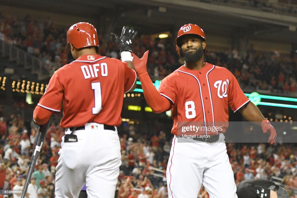 Brian Goodwin #8 of the Washington Nationals celebrates a solo home run with Wilmer Difo #1 in the fifth inning during game two of a doubleheader against the Colorado Rockies at Nationals Park on July 30, 2017 in Washington, DC.